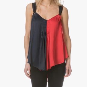 Leave  a lasting impression with this gorgeus Two-tone top from by Malene Birger  Red and Dark Blue Np: 1921kr  Mp 499kr   Vil bytte med str: Medium  Sender via Dao 37kr