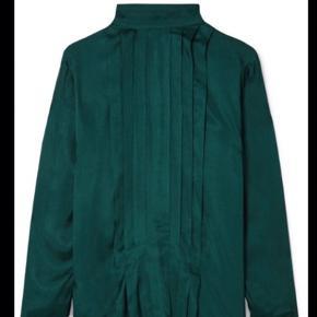 By Malene Birger skjorte i str. 34 aldrig brugt. Kom evt med et bud.   Sender med DAO og køber betaler selv fragt.