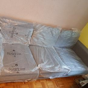 Canapé tissu gris neuf jamais utilisé,je le met en vente car malleureusement il est trop grand pour la pièce.