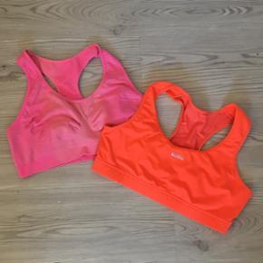 To stk. sportsbh'er. Den lyserøde er fra H&M og brugt/vasket et par gange.  Den orange er fra Ozon og er aldrig brugt.  God kvalitet.  Kan afhentes i Aalborg Ø eller sendes på købers regning. Kan evt. leveres i Aalborg-området ved nærmere aftale  Sælges for: 70kr. samlet eller 50kr. pr. del.