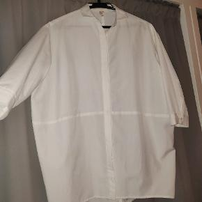 Oversize white button down shirt with 3/4 sleeved from Essential Line