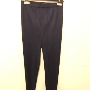 Pleats Please by Issey Miyake  Classic Navy trousers - slightly narrow and cropped model   Size 4 - fits perfect for Small- Medium also Large due to elastic waist  Waist 33 Length 91  Like new never worn