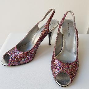 Flotte konfetti glimmer glitter sko fra rudi & Harald Nielsen. De er lidt små i størrelsen (40,5). Ca. 10 cm hæl. Aldrig været brugt. 👠