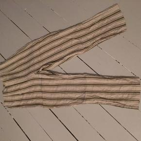 Off-white hem trousers with khaki stripes. High-waisted. I cut out the label so the size could be Small or Medium.