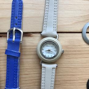 Ur med forskellige remme og skiver, som kan skiftes (10 skiver og 5 remme). Uret er gået i stå. Aldrig brugt.