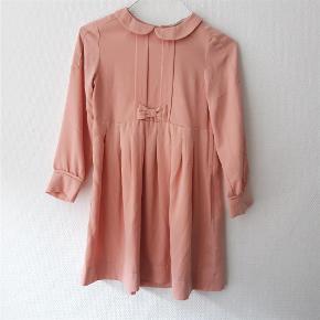 Brand: H&M Kids Varetype: Sød kjole Størrelse: 7år Farve: Rosa  100% polyester