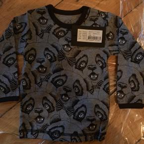 Fin trøje med panda print. Helt ny med prismærke.  Str. 79.Nypris 179,-