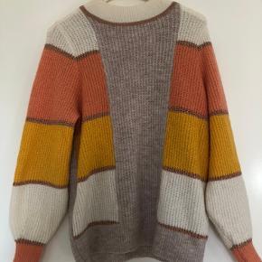 Lækker sweater, kradser ikke og er en smule oversize :)