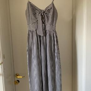 Summer dress with a bow in front. Black and white stripes. Zipper in a back
