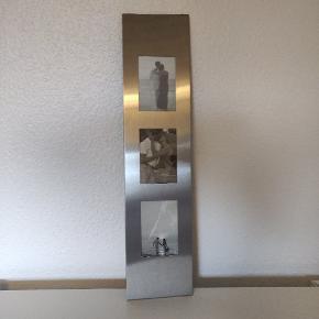 Fotoramme i aluminium. Måler 60x14 cm, der er plads til e billede af 8x12cm.