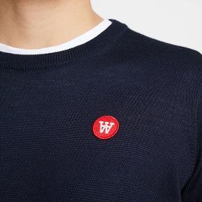 Super lækker pullover fra Wood Wood.  Ubrugt med tags / prismærke.  Model : Kip pullover  ( helt ny model )  Pris i forretningerne = 1200 kr.  Lavet i 100 % organisk uld.  Rigtig lækker kvalitet.  MobilePay eller TS handel.  Prisen er fair og fast.  PRISEN FORHANDLES IKKE.
