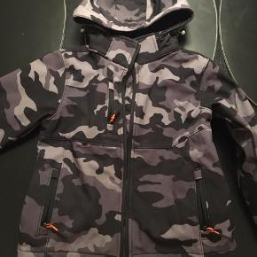 Soft Shell jakke fra M79 i grå camouflage.