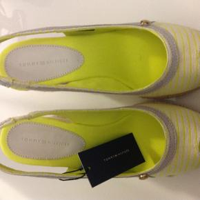 yellow/white striped Tommy Hilfiger Plateaus. very cool peep toe. new price was 250 still with price tag