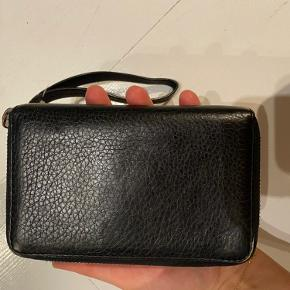 Real leather black wallet / clutch with silver trims. In good condition