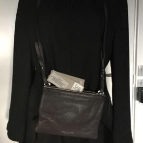 Never worn , new price 1500 dkk