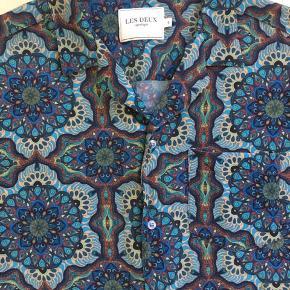 Fed sommer skjorte, i lækker kvalitet Brugt få gange Str L  Se mange flere annoncer på profilen