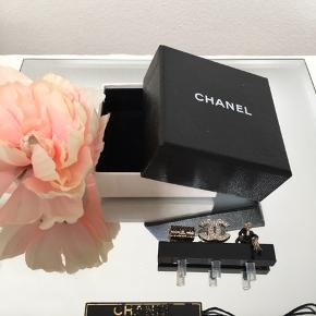 🖤🖤 CHANEL 🖤🖤  Small iPhone charms from 2013.  Karl Lagerfeld made small coco iPhone charms to plug into headphone entry.  This is a rare pair, brand new.  There is a small Chanel 2,55 bag, coco herself and a CC logo charm with crystals. Comes in the original Chanel box with tag. ⭐️💛💫