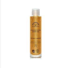 Golden kis body oil fra Rudolph Care. Ej brugt, blot pakket ud. Nypris 399 kr