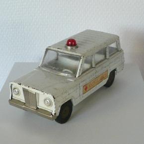 Gammel Ambulance i blik. Produceret i Japan mærke Cragstan. Længde 18cm. Højde 8cm.