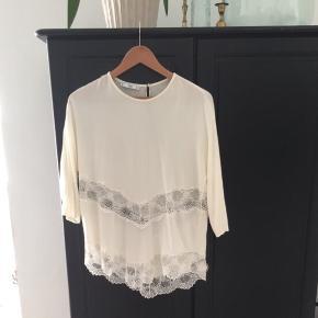 Hvid/beige bluse/top fra Mango i str. M.