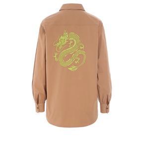 Skjorte fra hosbjerg med neon detalje på ryggen  Flot både åben og lukket  Kun brugt få gange så står derfor som ny  Kom gerne med bud