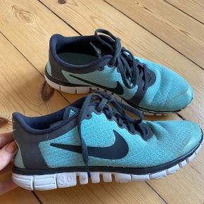 Nike Free 3.0 træningssko i turkis med mørkegrå.