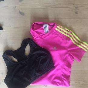 Både sport-bh og Adidas løbe t-shirt for 80 kroner. I trøjen står der størrelse 42, men kan sagtens bruges af en 38. Sports BH-en passer til en c-skål.