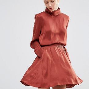 Fin nederdel i silke med lommer