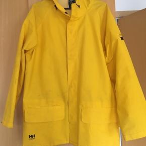 03483cf4 Gul Helly Hansen regnjakke. Work wear - virkelig god kvalitet.