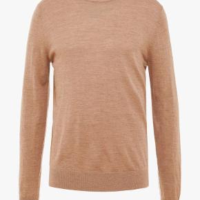 Helt ny pullover/sweater i 100% uld, fra Tiger of Sweden, model Nichols, str. L, farve camel, aldrig været brugt, stadig med tags.