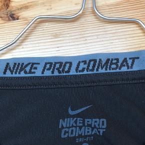 NIKE PRO COMBAT t-shirt  Str. XL (Børnestørrelse, angivet)  OBS - passer IKKE str. XL, men derimod str. Xs/S  Stand: 8/10  Pris: Kom med et bud