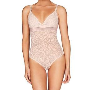 Stella McCartney bodysuit in peach. Size small, fit true to size. Np 800 mp 300