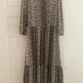 Mid length midi leopard dress. Can be dressed up or dressed down. No Swaps